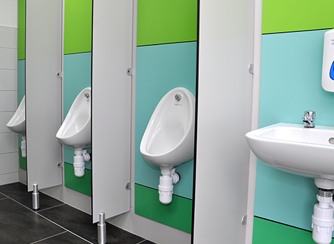 Alternated coloured urinal wall panles